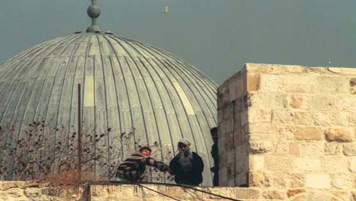 In times of tension the Muslim worshippers at Al-Aksa have attacked the worshippers at the Western Wall, hurling stones at them as here in the mid-'90s. (Avi Ochayon, Government Press Office)