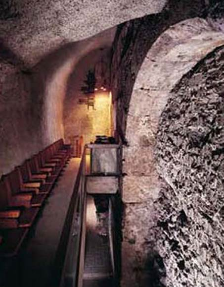 "Facing the ""Holy of Holies"" (the site of the Jewish Temple) in the Western Wall Tunnel. On the right: the concrete blockage from 1981. The gate was sealed at the order of then-prime minister Menachem Begin to prevent passage under the Temple Mount. (courtesy of the Western Wall Heritage Foundation)"