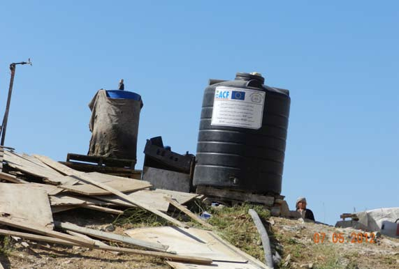 Water tanks at an illegal construction site in the Maale Adumim area, supplied by the humanitarian organization ACF and the European Union.