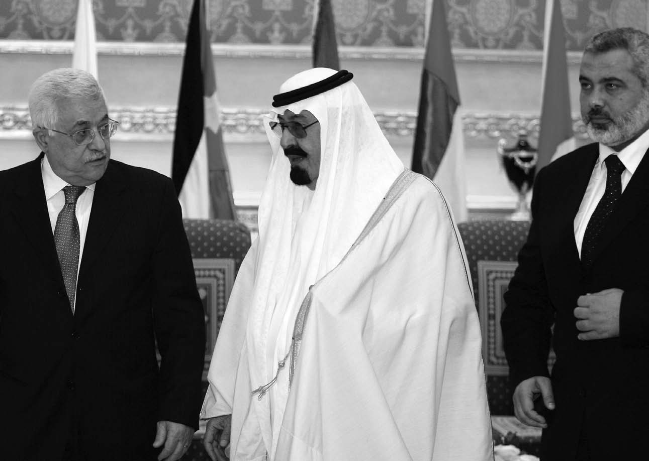 Saudi King Abdullah bin Abd al-Aziz, center, speaks to Palestinian leader Mahmoud Abbas, lef, as Prime Minister Ismail Haniyeh of Hamas, right, looks on in Riyadh on March 27, 2007, prior to an Arab League Summit meeting.