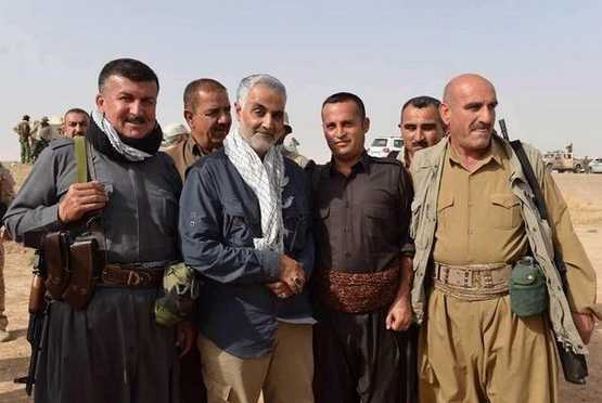 "Qassem Suleimani, with scarf, the commander of the Revolutionary Guards Quds force, poses with a group of Kurdish Peshmerga fighters - Iran: Sana'a, Yemen Is ""the Fourth Arab Capital in Our Hands"""