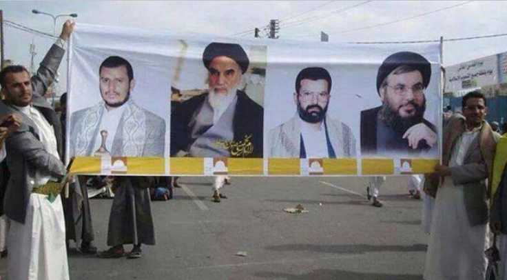 Houthis unfurl banner in Sana'a with pictures of (from left) current Houthi leader Abd Al-Malik Al-Houthi, Iranian Ayatollah Khomeini, the late Houthi founder and leader Hussein Badreddin al-Houthi, and Hizbullah leader Hassan Nasrallah.