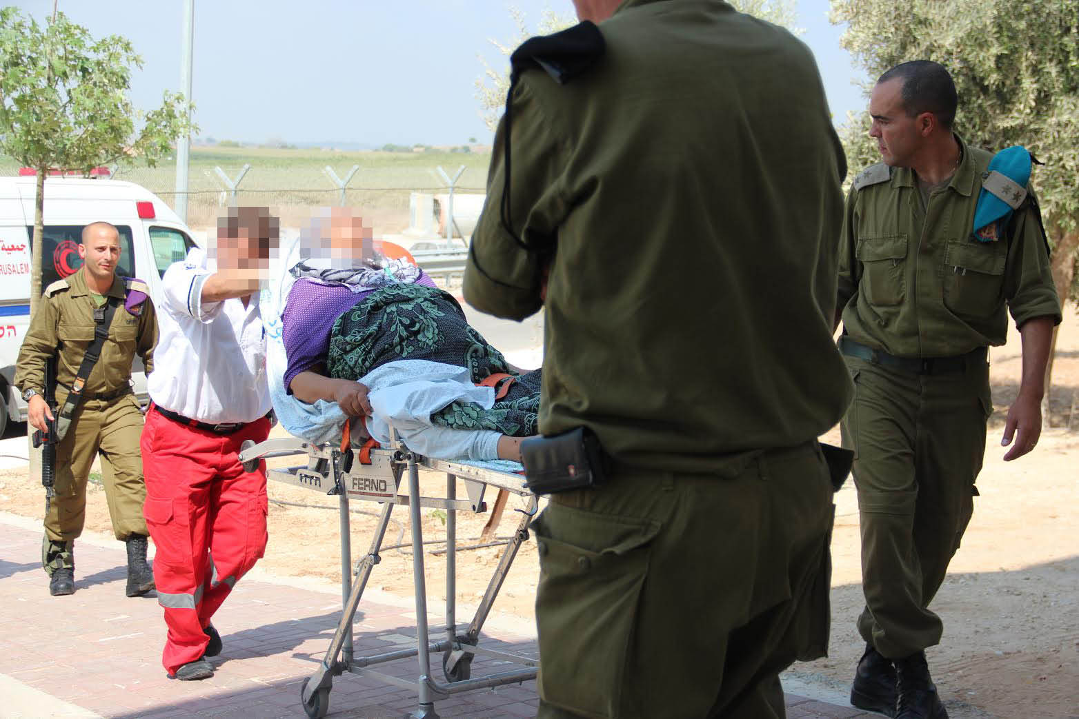 Israel and the Gaza Strip: Why Economic Sanctions Are Not Collective Punishment The IDF Medical Corps treating injured Palestinian civilians at the Erez Border Crossing. (IDF Flicker)